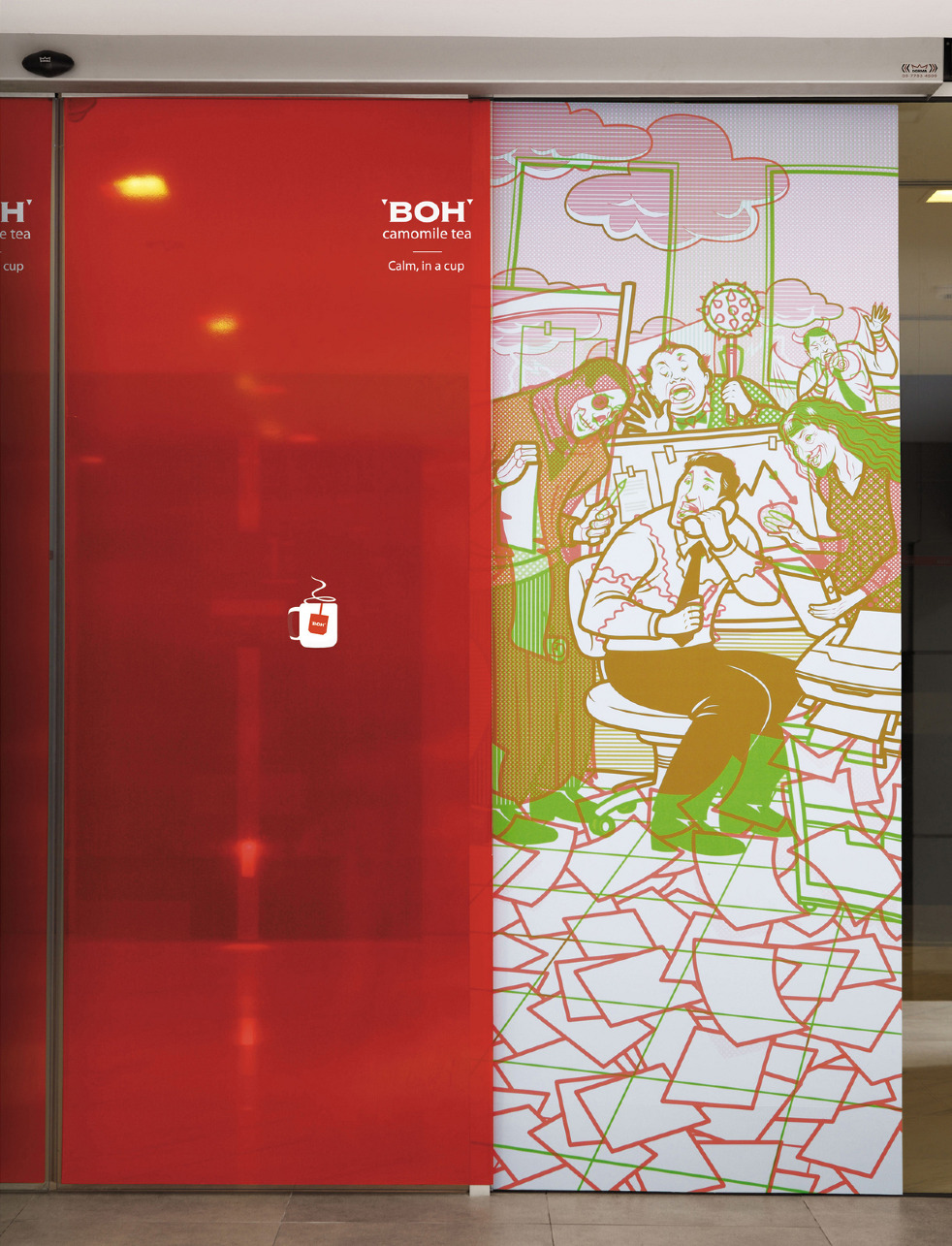 NOTE - One glass sliding door has a coloured image of a harried office worker. When the other door with a red transparent poster panel (featuring a cup of & Boh / Sliding Doors - Neil Leslie